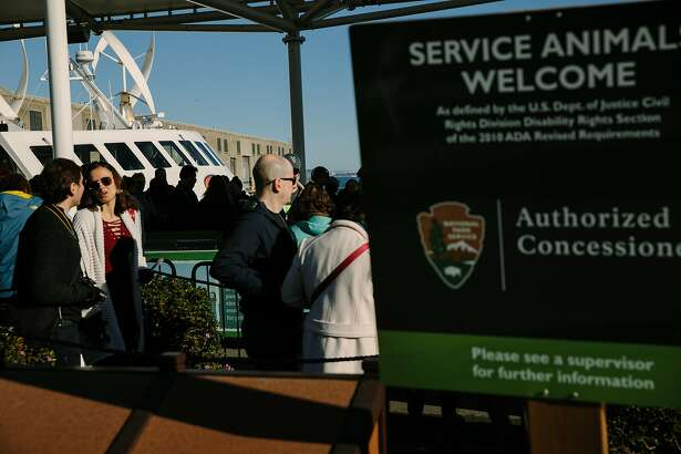 People wait to board the Alcatraz Cruises for Alcatraz Island in San Francisco, Calif. Saturday, Jan. 20, 2018. Despite government shutdown, Alcatraz Island remained open.