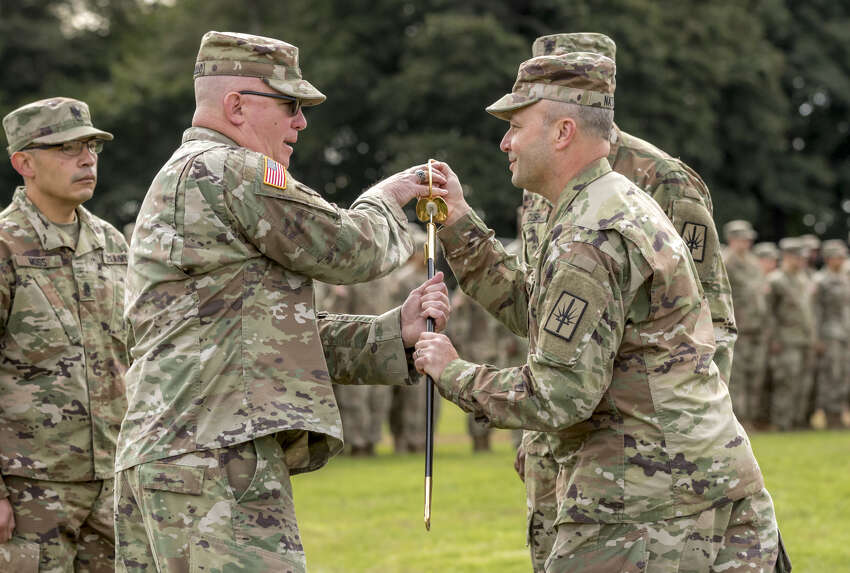 U.S. Army Brig. Gen. Michel Natali, commander, 53rd Troop Command, New York Army National Guard, passes the noncommissioned officer sword to Command Sgt. Maj. Thomas Ciampolillo, incoming command sergeant major of the 53rd Troop Command, during a change of responsibility ceremony at Camp Smith Training Site, Cortlandt Manor, N.Y., Oct. 14, 2018. The ceremony marked the change of the 53rd Troop Command's senior enlisted advisor from outgoing Command Sgt. Maj. Corey K. Cush to incoming Command Sgt. Maj. Ciampolillo.