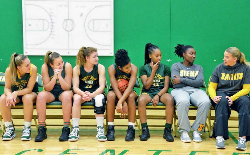 Head coach Ali Jaques, right, with players during Siena women's basketball media day Tuesday Oct. 16, 2018 in Colonie, NY. (John Carl D'Annibale/Times Union)