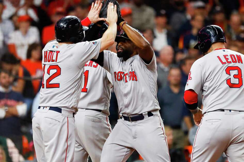 The Boston Red Sox celebrate after a Jackie Bradley Jr. grand slam gave them an 8-2 lead during the eighth inning of Game 3 of the American League Championship Series at Minute Maid Park on Tuesday, Oct. 16, 2018, in Houston.