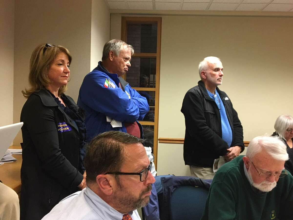 From left, Alder Anna Festa; Frank Gargano, Frank Gargano, president of the St. Michael's Church finance committee; and church trustee Mel Sansevarino address the Wooster Square Downtown Community Management Team meeting about St. Michael's proposed development.