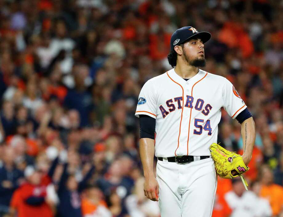 Houston Astros relief pitcher Roberto Osuna (54) reacts as he allows a grand slam to Boston Red Sox Jackie Bradley Jr. (19) to give the Red Sox a 8-2 lead in the eighth inning of Game 3 of the American League Championship Series at Minute Maid Park on Tuesday, Oct. 16, 2018, in Houston. Photo: Karen Warren, Staff Photographer / © 2018 Houston Chronicle