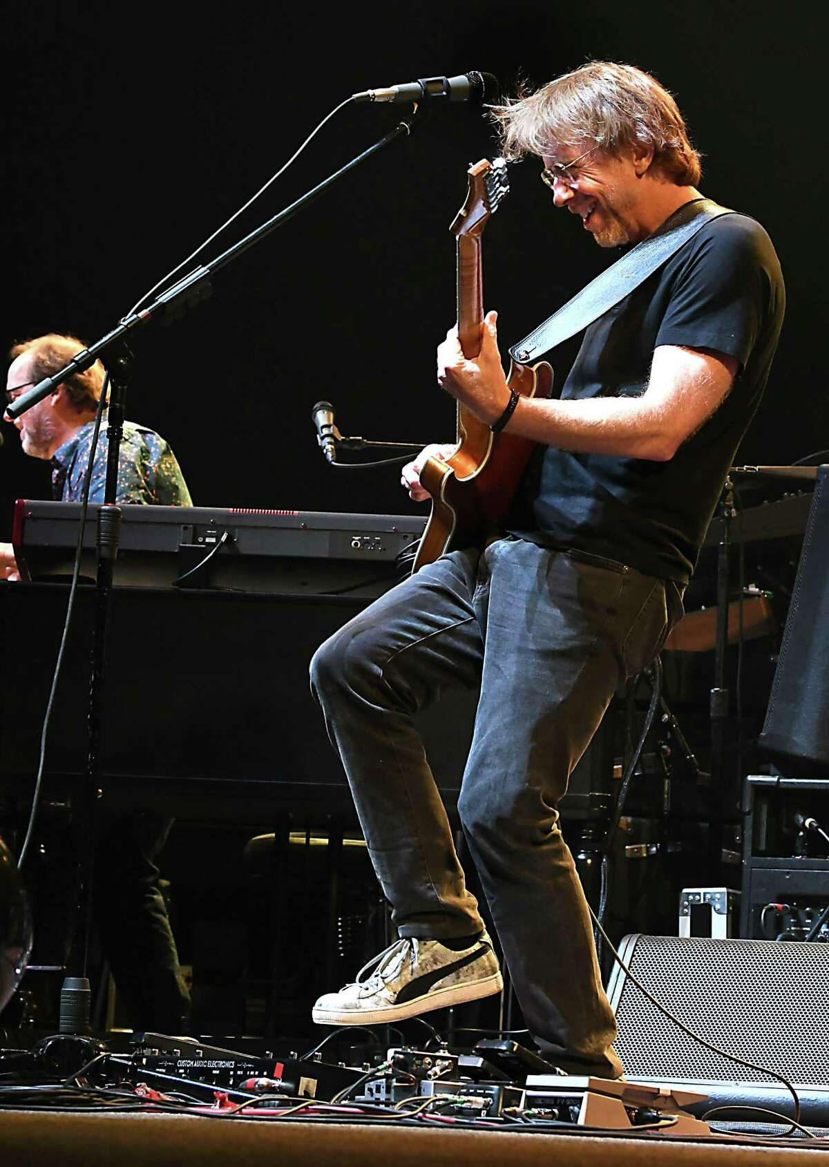 Lead vocalist and guitarist Trey Anastasio plays his guitar as Phish performs at the Times Union Center on Tuesday, Oct. 16, 2018 in Albany, N.Y. (Lori Van Buren/Times Union)