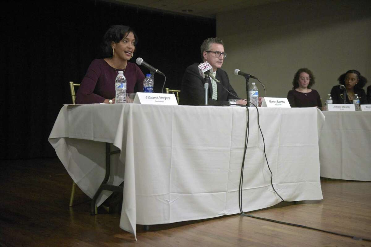 Democrat Jahana Hayes, left, and Republican Manny Santos, candidates for the 5th Congressional District in Connecticut, debate at the Portuguese Cultural Center in Danbury on Tuesday.