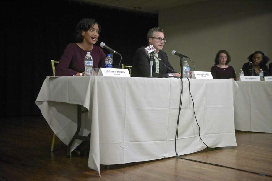 Democrat Jahana Hayes, left, and Republican Manny Santos, candidates for the 5th Congressional District in Connecticut, debate at the Portuguese Cultural Center in Danbury on Tuesday. Photo: H John Voorhees III / Hearst Connecticut Media / The News-Times