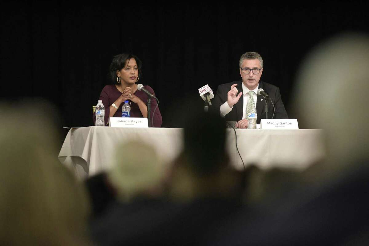Democrat Jahana Hayes, left, and Republican Manny Santos, candidates for the 5th Congressional District, debate at the Portuguese Cultural Center in Danbury Tuesday night.