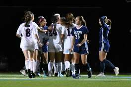 Members of the Brien McMahon Senators celebrate a first half goal by Darlene Salguero during a game against the Wilton Warriors on Tuesday October 16, 2018, at Wilton High School in Wilton, Connecticut.