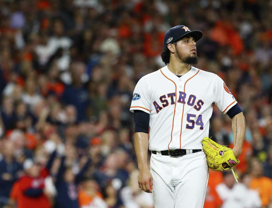 Houston Astros relief pitcher Roberto Osuna (54) reacts as he allows a grand slam to Boston Red Sox Jackie Bradley Jr. (19) to give the Red Sox a 8-2 lead in the eighth inning of Game 3 of the American League Championship Series at Minute Maid Park on Tuesday, Oct. 16, 2018, in Houston. Photo: Karen Warren, Houston Chronicle / Staff Photographer / © 2018 Houston Chronicle