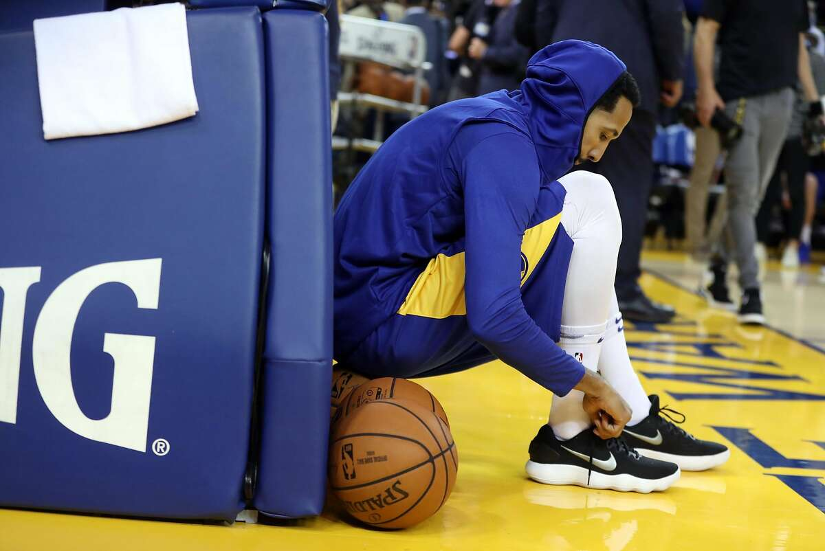 Golden State Warriors' Shaun Livingston readies to warm up before playing Oklahoma City Thunder in Opening Night game at Oracle Arena in Oakland, Calif. on Tuesday, October 16, 2018.