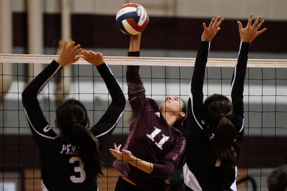 Lee's Yali Flores (11) hits past Permian Oct. 16, 2018 at Lee High School.  James Durbin/Reporter-Telegram Photo: James Durbin / ? 2018 Midland Reporter-Telegram. All Rights Reserved.