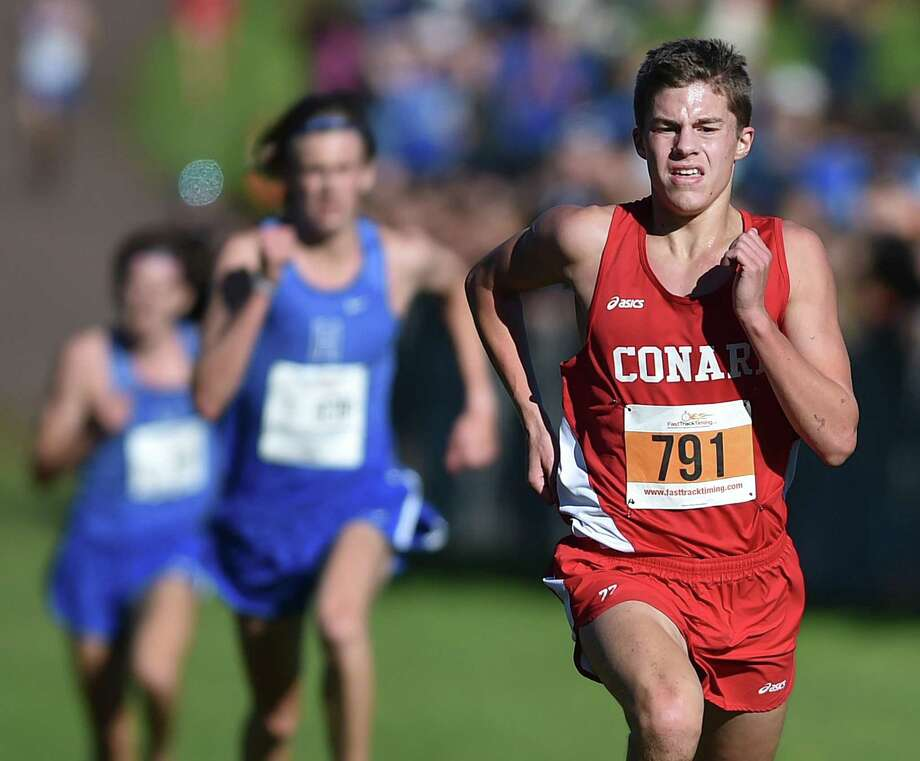 Conard freshman Gavin Sherry, the first place finisher won the CCC cross country championships in 16:16.0 Tuesday, October 16, 2018, at Wickham Park in Manchester. Photo: Catherine Avalone / Hearst Connecticut Media / New Haven Register