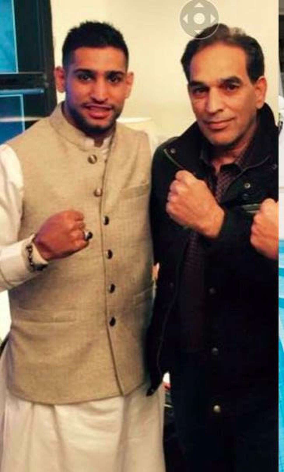 Professional boxer Amir Khan, left, in a photo with Shahed Hussain that he says was taken in 2016 at the home of Malik Riaz Hussain, a wealthy Pakistaini businessman.