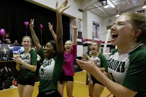 Members of The Woodlands Christian Academy team react after defeating Northland Christian School in five sets to win the TAPPS District 7-4A championship during a high school volleyball match at Northland Christian School, Tuesday, Oct. 16, 2018, in Houston.