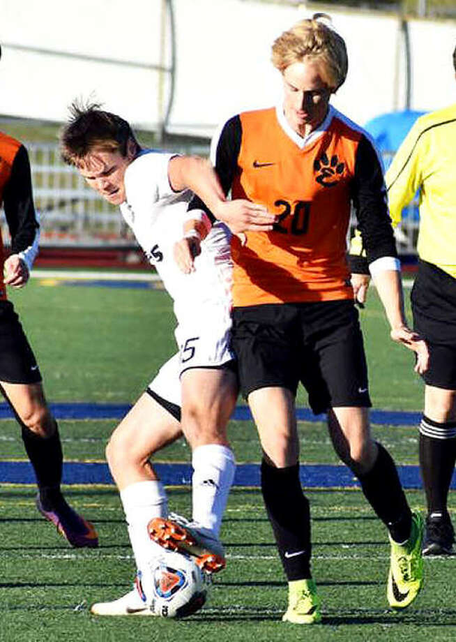 Belleville West's Mitch Oplt (5) battles for the ball with Ashton Kaufman of Edwardsville during Tuesday's Class 3A regional semifinal in O'Fallon. Photo: Matt Kamp | For The Telegraph