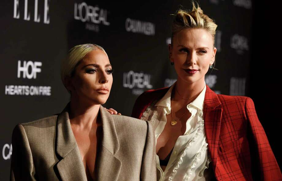 Honorees Lady Gaga, left, and Charlize Theron pose together at the 25th Annual ELLE Women in Hollywood Celebration, Monday, Oct. 15, 2018, in Los Angeles. (Photo by Chris Pizzello/Invision/AP) Photo: Chris Pizzello / 2018 Invision
