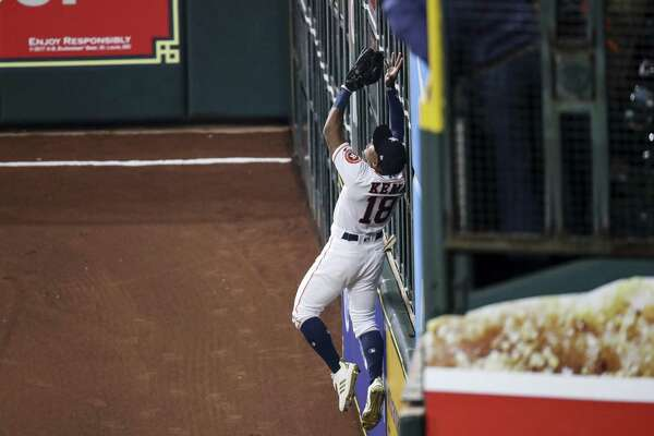 Houston Astros left fielder Tony Kemp (18) catches a high fly ball off the wall to end the top of the third inning of Game 3 of the American League Championship Series at Minute Maid Park Tuesday Oct. 16, 2018 in Houston.