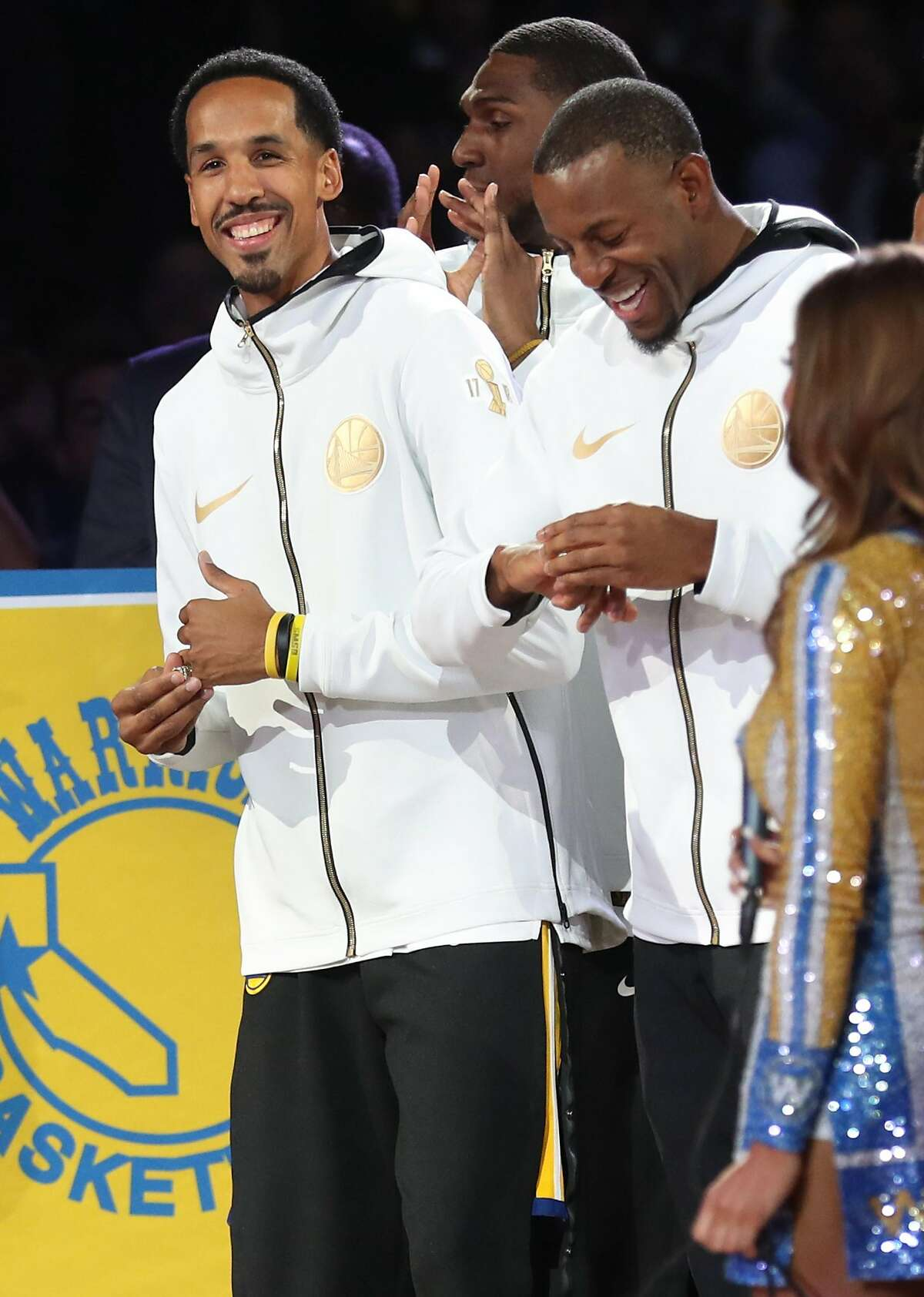 Golden State Warriors' Shaun Livingston and Andre Iguodala enjoy the Warriors' 2018 NBA Championship ring ceremony before Opening Night game against Oklahoma City Thunder at Oracle Arena in Oakland, Calif. on Tuesday, October 16, 2018.