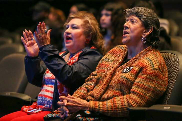 O'Rourke supporters Elia Garcia (right) and Della Jimenez watch the televised debate between Senate candidates Ted Cruz and Beto O'Rourke from their seats in the Palo Alto College Performing Arts Center on Tuesday, Oct. 16, 2018.