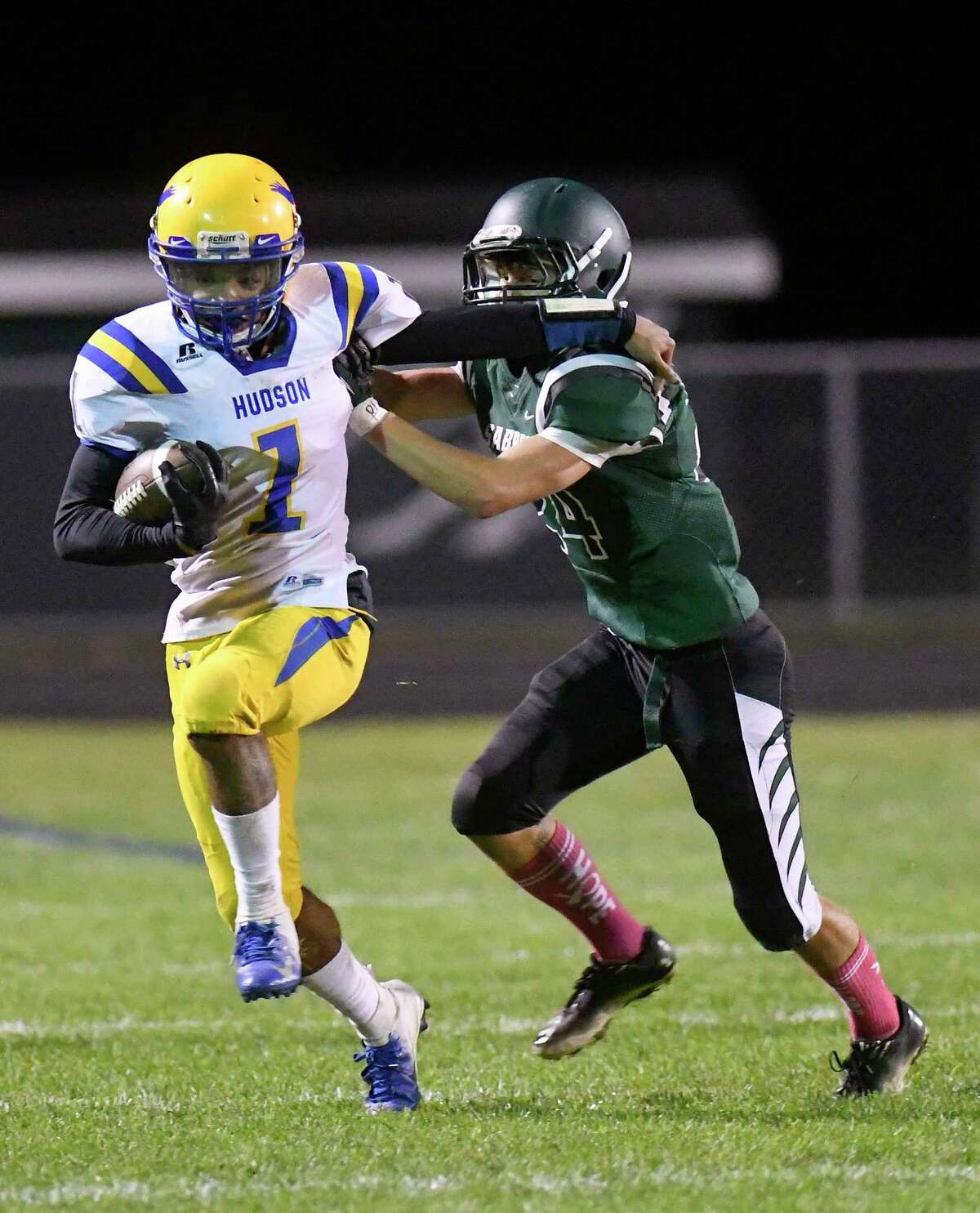 Hudson's Jose Wallace (1) runs the ball past Schalmont's Gannon Strube (24) during a Section II Class B High School football game Tuesday, Oct. 16, 2018, in Colonie, N.Y. (Hans Pennink / Special to the Times Union)