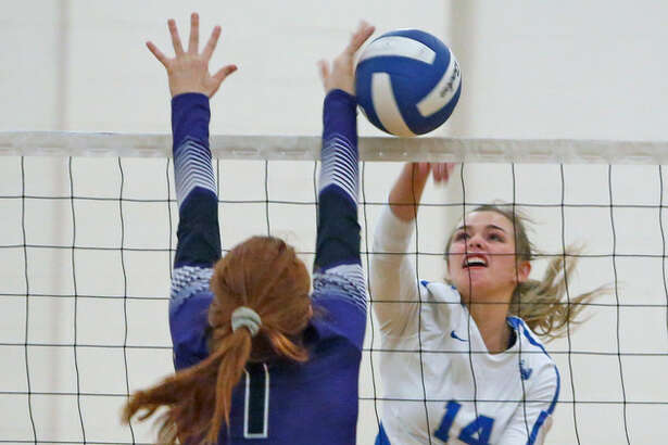 La Vernia's Morgan Vajdos knocks the ball past Navarro's Madison McCraig during their District 30-4A showdown.