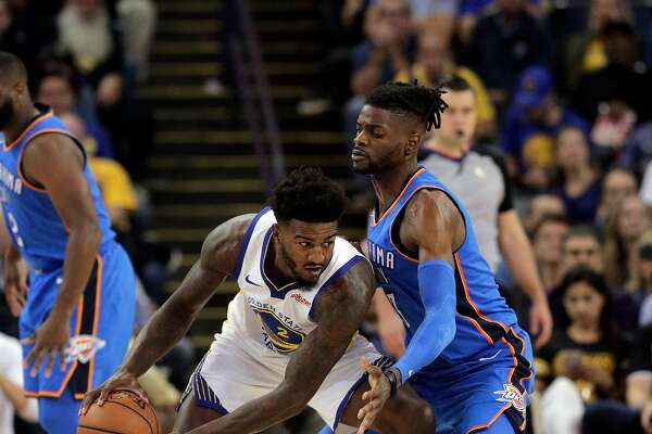 Jordan Bell (2) defended by Nerlens Noel (3) in the second half as the Golden State Warriors played the Oklahoma City Thunder at Oracle Arena in Oakland, Calif., on Tuesday, October 16, 2018. The Warriors received their 2018 NBA Championship rings and saw their championship banner raised in the arena before the game.