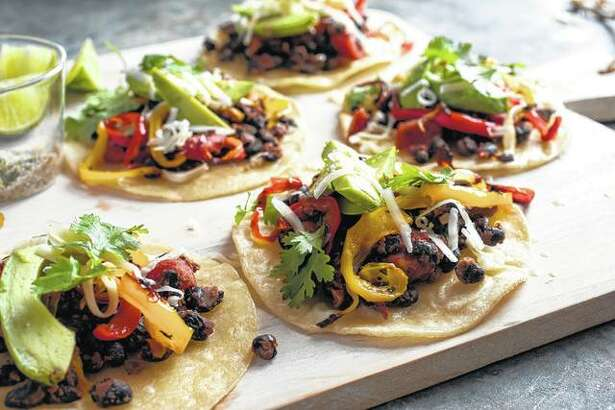 Black beans and peppers on crisp tortillas prove it's no harder to build a sheet-pan supper around a vegetarian protein, and there are more options than you might initially think.