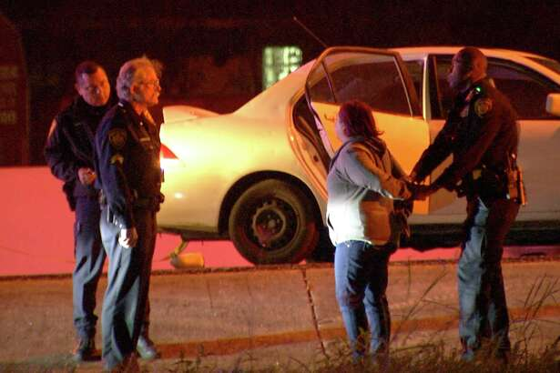 A suspected drunk driver ran over a man stopped on the side of Northwest Loop 410 on Tuesday, critically injuring him, according to police.