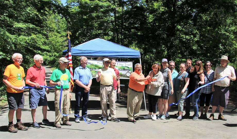 Members of the Air Line Trail Steering Committee take part in a ribbon cutting for the Portland portion of the route in early June. They are among four groups to be honored with a Rockfall Foundation environmental award. Photo: Contributed Photo