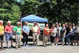 Members of the Air Line Trail Steering Committee take part in a ribbon cutting for the Portland portion of the route in early June. They are among four groups to be honored with a Rockfall Foundation environmental award.