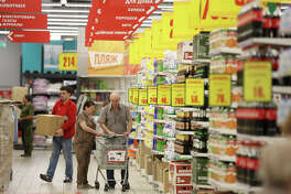 Customers browse products in a discount aisle of a supermarket in Moscow on Aug. 1, 2017.