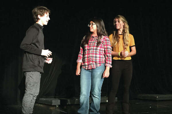 """Lincoln Middle School presents """"Act One - One Acts"""" Drama Production Friday and Saturday at 7:00 p.m. in the school's auditorium. The drama students will present two short, one act plays """"10 Ways to Survive the Zombie Apocalypse"""" and """"Scared Silly."""" Within """"Scared Silly"""" are three small one act plays - """"Rocky Junction,"""" """"In the Waiting Room at the Ghost Placement Agency"""" and """"Forever Friends."""" Performers pictured from left are: Jackson Wylie, Jasmine Khan and Brooke Blythe."""