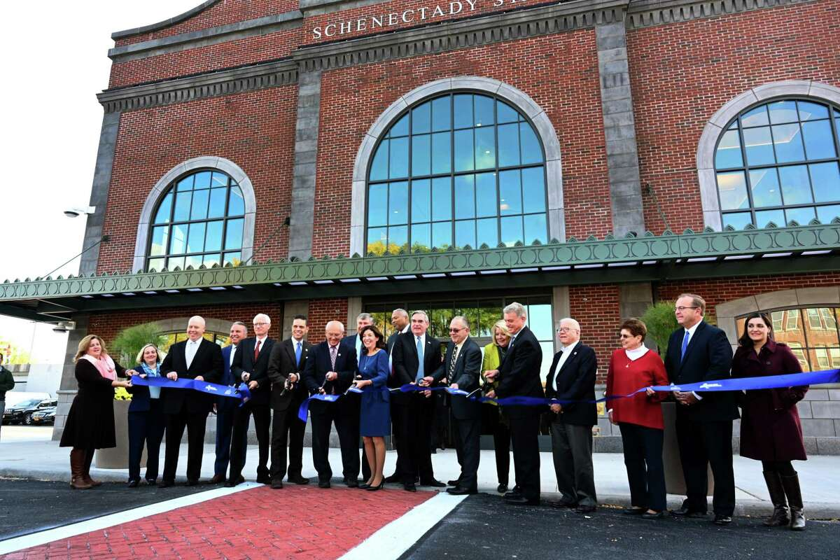 Lt. Governor Kathy Hochul, center, cuts the ceremonial ribbon with state, federal and local officials at the opening of the new Schenectady train station officially opened Wednesday Oct.17, 2018 in Schenectady, N.Y. (Skip Dickstein/Times Union)
