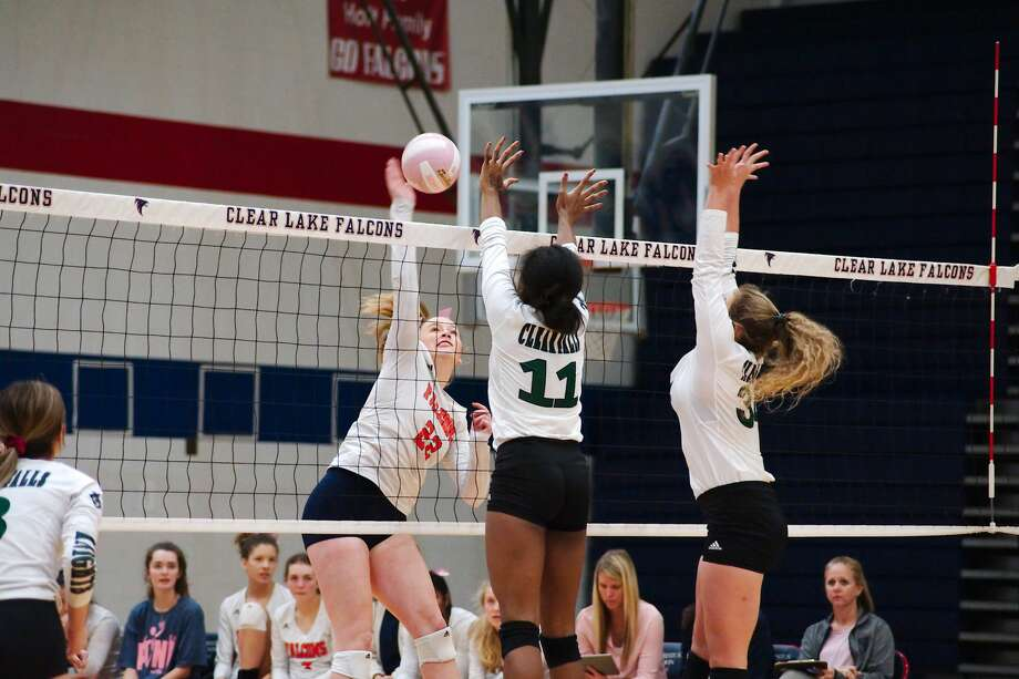 Clear Lake's Emma Norman (22) triestohit a shot past Clear Falls' Rachel Brown (11) and Clear Falls' Blakely Montgomery (34) Tuesday, Oct. 16 at Clear Lake High School. Photo: Kirk Sides/Houston Chronicle
