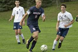 Greens Farms Academy boys soccer player Jack Ramsay, a resident of Darien, dribbles the ball during a game earlier this season.