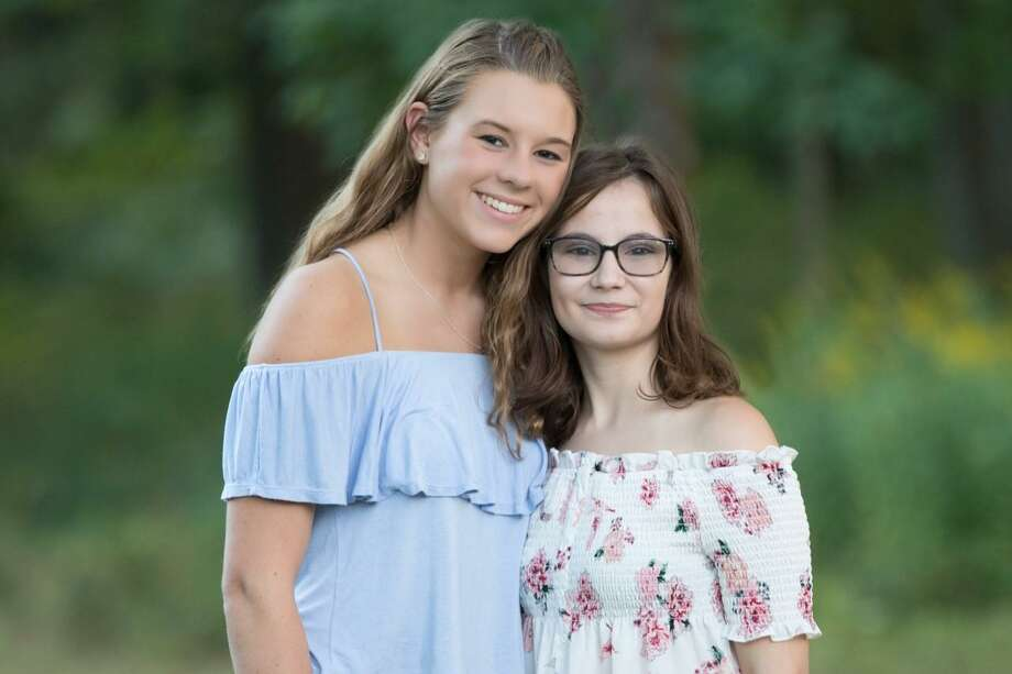 Julia Morneau (left), pictured her with her mentee Georgia Mills, recently won the Rising Scientist Award for her work raising mental health awareness. Photo: Contributed Photo