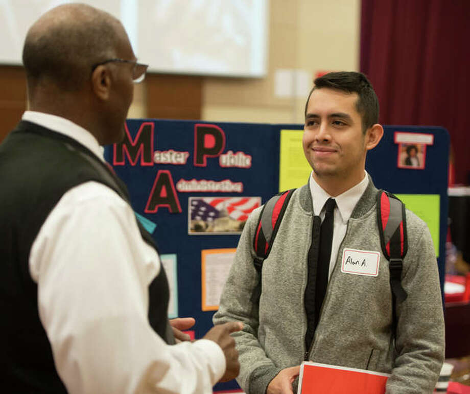 Alan Ayala, of Springfield, met with Morris Taylor, PhD, associate professor and chair of the public administration and policy analysis program, during SIUE's Graduate School Open House. Photo: For The Telegraph