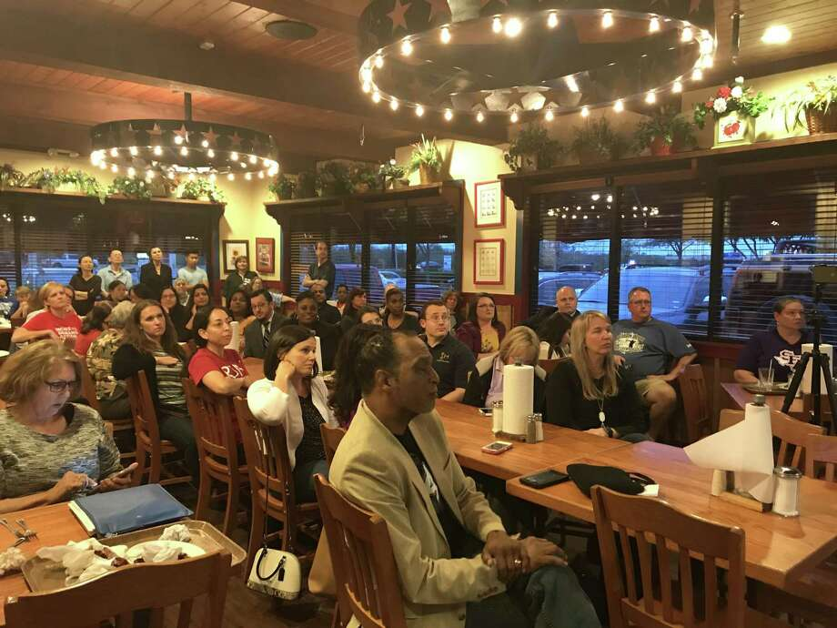 Parents and community members attend Pearland ISD trustee Mike Floyd's March town hall meeting at Spring Creek Barbeque. The district's board recently agreed to stage forums for the community twice a year at district facilities.