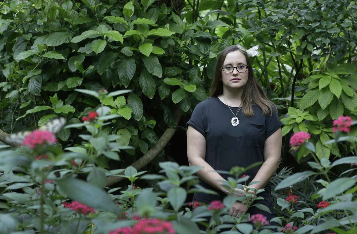 Poet Holly Walrath is shown in the Cockrell Butterfly Center in Houston.