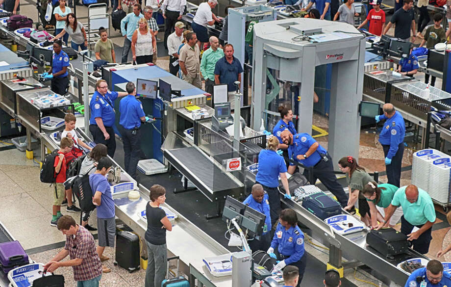 Airport security is always a bottleneck, but it gets worse during peak summer season, especially on weekends. Photo: Jim Glab