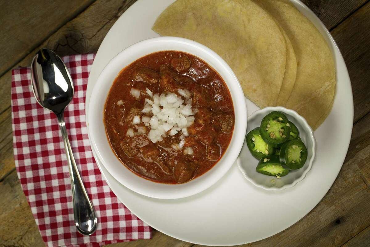 """Chili Queen Chili: Recipe adapted from """"The Chili Cookbook"""" by Robb Walsh. It's made with diced beef chuck and pork shoulder simmered in a dried chile paste."""