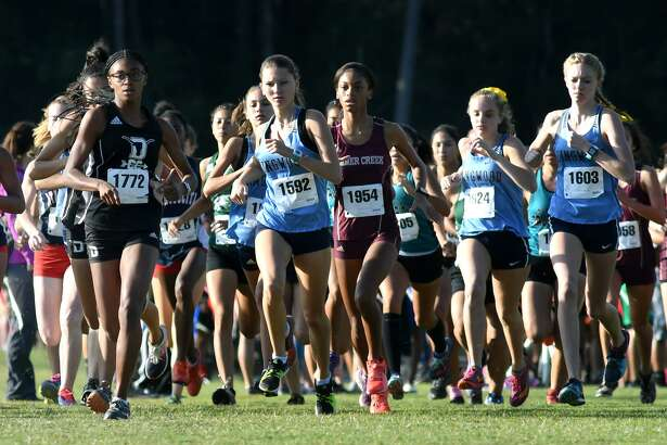 Dobie's Amari Singleton (1772), Kingwood's McKenzie Clark (1592), Summer Creek's Mykayla Mims (1954), and Kingwood's Rachel James (1603) lead the pack at the start of the Varsity Girls Race at the 22-6A District Cross Country Meet held at Atascocita High School on Oct. 11, 2018.