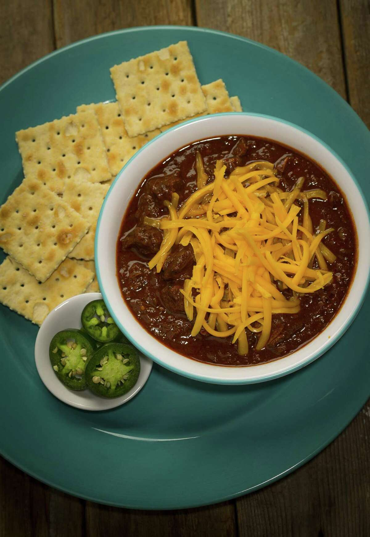 """Seven-Chile Texas Chili from """"The Homesick Texan Cookbook"""" by Lisa Fain is made using chuck roast simmered in a dried chile paste and plenty of spices including cinnamon, clove and allspice as well as brewed coffee and beer."""
