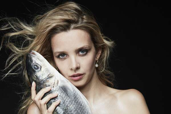 Greta Bellamacina poses with a seabass as part of the Fishlove photo campaign to stem overfishing in European waters.
