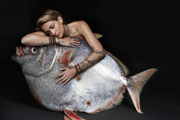 Paris Jackson poses with an opah fish as part of the Fishlove photo campaign to stem overfishing in European waters.