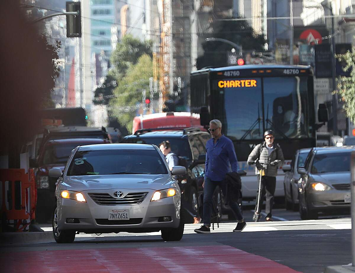 An Uber car seen stopped in traffic while waiting for a passenger on Mission St. near Fremont St. on Monday, Oct. 15, 2018 in San Francisco, Calif.