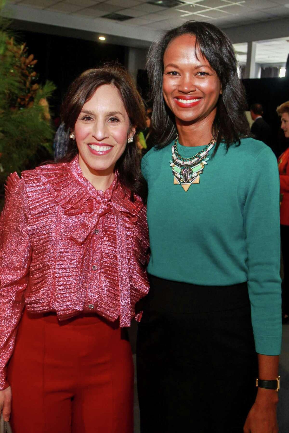 Rosa Maria Villagomez, left, and Precious Owodunni at the Houston Parks Board's annual luncheon.