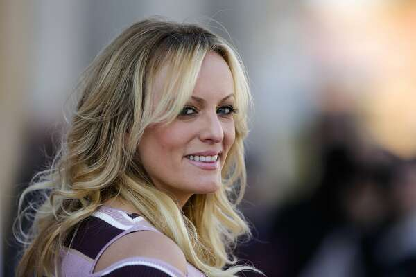 "In this Oct. 11, 2018 photo, adult film actress Stormy Daniels attends the opening of the adult entertainment fair 'Venus' in Berlin, Germany. When President Donald Trump called Daniels ""horseface"" on Twitter, he added to his long list of creative, some say misogynistic, descriptions for women. A look at how Trump's words, and his attitude, might play out three weeks before an election that features a record number of women candidates. (AP Photo/Markus Schreiber)"