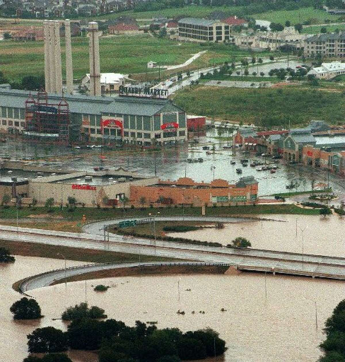 The intersection of Basse Road and Highway 281 is flooded in San Antonio, after storms closed several highways in the area Sunday, Oct. 18, 1998. Drenching storms swept through Texas killing twenty-nine people.