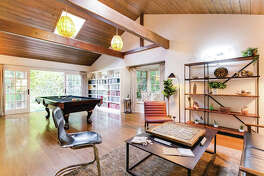 "This undated photo provided by Airbnb Plus shows a home in the Bel Air neighborhood of Los Angeles. Stocking your vacation rental with games, books and other recreational amenities, and having professional photos taken of your home, will make it a draw for potential renters, says real estate expert and co-host of Netflix's ""Stay Here"" series Peter Lorimer."