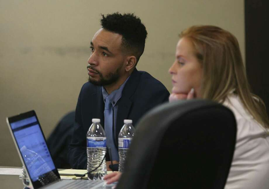 Former Ballet San Antonio star Hugo Ihosvany Rodriguez, left, sits with his defense team including Stacie Deline, right, on Tuesday. Photo: Jerry Lara /Staff File Photo / © 2018 San Antonio Express-News